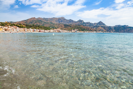 travel to Sicily, Italy - clear water on Ionian sea near Giardini Naxos town in summer