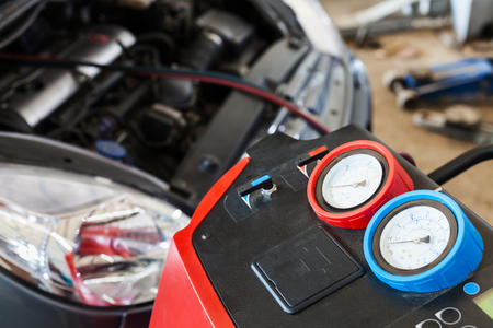 refueling of car air conditioner in auto repair shop Stock Photo