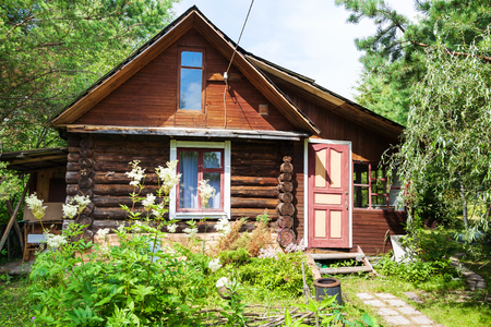 front view of log house in russian village in sunny summer day Stock Photo