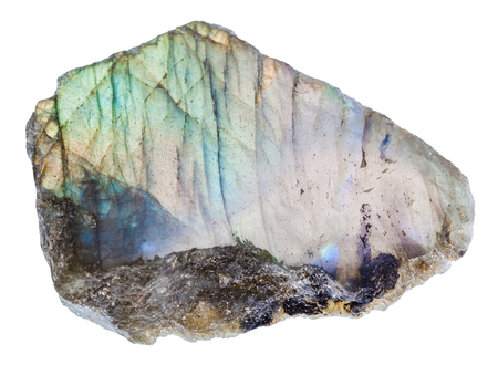 macro shooting of natural mineral rock - labrador (labradorite) stone with polished surface of isolated on white background from Madagascar