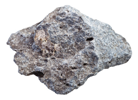macro shooting of specimen of natural igneous rock - gray porous basalt stone isolated on white background from Russia
