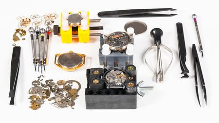pinzas: watchmaker workshop - top view of watch repairing tools on white background Foto de archivo