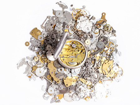 watchmaker workshop - top view of open silver pocket watch on pile of old clock spare parts on white background Stock Photo