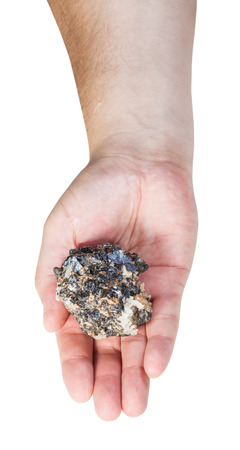 gemmology: top view of zinc and lead mineral ore (sphalerite with galena) on male palm isolated on white background