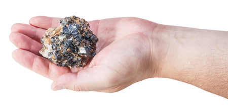 sphalerite: piece of zinc and lead mineral ore (sphalerite with galena) on male palm isolated on white background