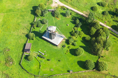 above view of old wooden windmill near New Jerusalem (Novoiyerusalimsky, Voskresensky Resurrection) Monastery in green hills near Istra town in Moscow Region in summer day