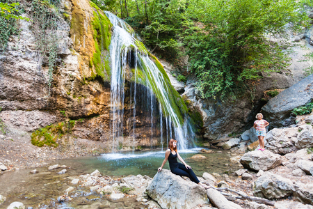 GENERALSKOE, CRIMEA - SEPTEMBER 22, 2017: tourists near Djur-djur waterfall on Ulu-Uzen river in Haphal Gorge of Habhal Hydrological Reserve. It is the most full-flowing waterfall in Crimea Editorial