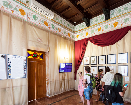 salvador dali museum: GASPRA, CRIMEA - SEPTEMBER 21, 2017: visitors on Salvador Dali exhibition inside of Swallow Nest Castle. The Castle was built in 1911-1912 in a Neo-Gothic style on top of the Aurora Cliff