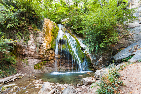 travel to Crimea - Ulu-Uzen river with Djur-djur waterfall in Haphal Gorge of Habhal Hydrological Reserve natural park in Crimean Mountains in autumn. It is the most full-flowing waterfall in Crimea