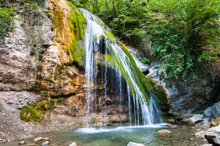 travel to Crimea - Djur-djur waterfall on Ulu-Uzen river in Haphal Gorge of Habhal Hydrological Reserve natural park in Crimean Mountains in september season Stock Photo