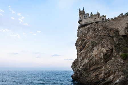 travel to Crimea - view of Swallow Nest Castle on Aurora Cliff of Ay Todor cape on Crimean South Coast of Black Sea on sunset Editorial