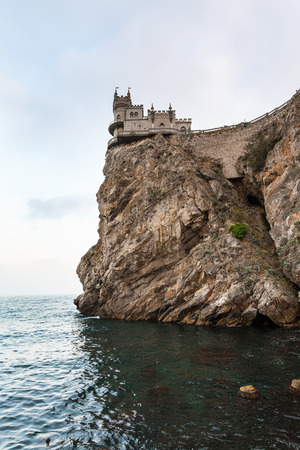 travel to Crimea - view of Swallow Nest Castle on Aurora Cliff of Ay Todor cape over Black Sea in evening Editorial