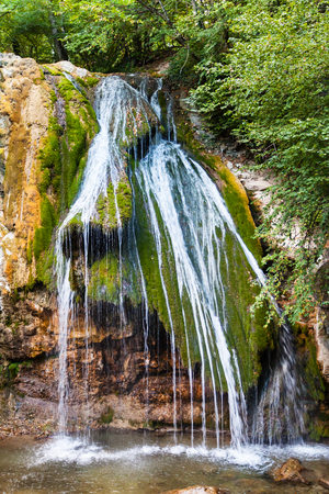 travel to Crimea - Djur-djur waterfall on Ulu-Uzen river in Haphal Gorge of Habhal Hydrological Reserve natural park in Crimean Mountains in autumn. It is the most full-flowing waterfall in Crimea