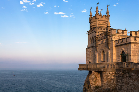 travel to Crimea - view of Swallow Nest Castle over Black Sea in Gaspra District on Crimean Southern Coast in sunset