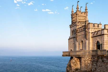 travel to Crimea - view of Swallow Nest Castle over Black Sea in Gaspra District on Crimean Southern Coast in evening