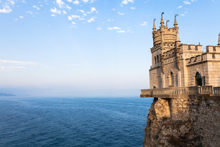 travel to Crimea - view of Swallow Nest Castle over Black Sea in Gaspra District on Crimean Southern Coast in autumn evening