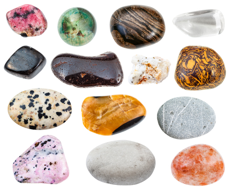collection of various natural mineral gemstones (greywacke, rhinestone, anthophyllite, dalmatian, mariam stone, hydrogoethite, calcite, rhodonite, rhodochrosite, stromatolite, andesine, etc) isolated