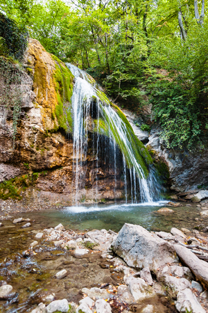 travel to Crimea - Djur-djur waterfall on mountain Ulu-Uzen river in Haphal Gorge of Habhal Hydrological Reserve natural park in Crimean Mountains in autumn
