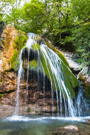 travel to Crimea - water flows in Djur-djur waterfall on Ulu-Uzen river in Haphal Gorge of Habhal Hydrological Reserve natural park in Crimean Mountains in autumn.