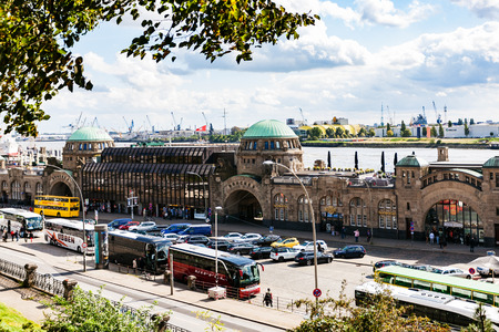 st german: HAMBURG, GERMANY - SEPTEMBER 15, 2017: above view of St. Pauli Landungsbrucken (Sankt Pauli Piers) landing place in Port of Hamburg between the lower harbour and Fischmarkt (Fish Market) on Elbe river Editorial