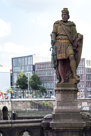 HAMBURG, GERMANY - SEPTEMBER 15, 2017: statue Count Adolf III (Graf Adolf III of Holstein, founder of new settlement for traders on riverbed of Alster near Neue Burg) on Trostbrucke in Hamburg city