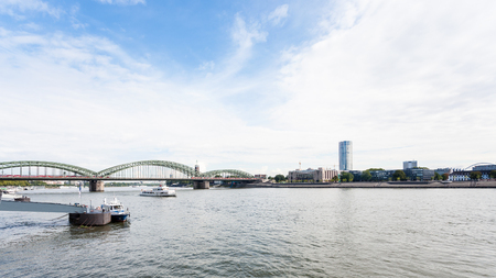 travel to Germany - pier and view of Rhine river with Hohenzollern Bridge (Hohenzollernbrucke) in Cologne city in september