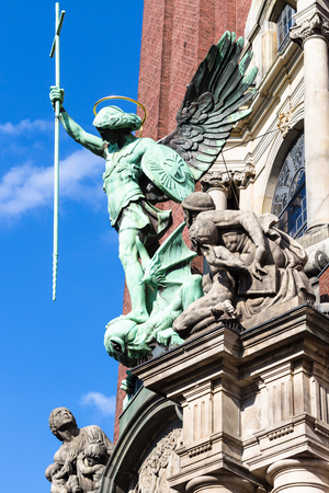 Travel to Germany - Victory of St Michael over the Devil, statue above the entrance of St Michaels church (Hauptkirche Sankt Michaelis) in Hamburg city Editorial