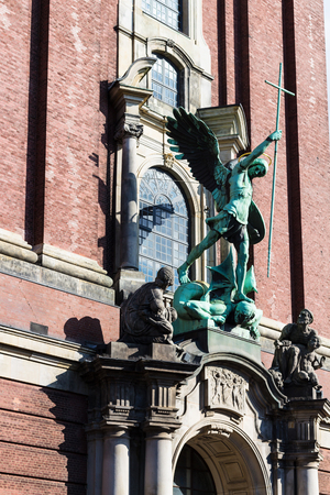 Travel to Germany - Victory of St Michael over the Devil, sculpture above the entrance of St Michael's church (Hauptkirche Sankt Michaelis) in Hamburg city Éditoriale