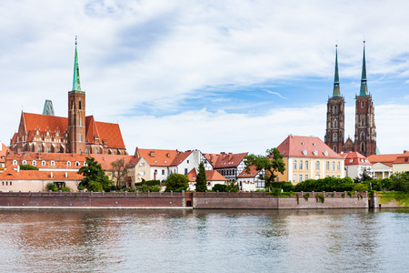 travel to Poland - view of Ostrow Tumski district in Wroclaw city with Collegiate Church of the Holy Cross and St Bartholomew, Cathedral of St John the Baptist, Archbishops, palace from Oder River