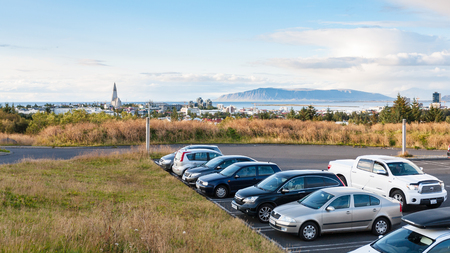 REYKJAVIC, ICELAND - SEPTEMBER 7, 2017: view of Reykjavik city with Hallgrimskirkja church from car parking of Perlan Museum in autumn evening. Reykjavik is the capital and largest city of Iceland. Editorial