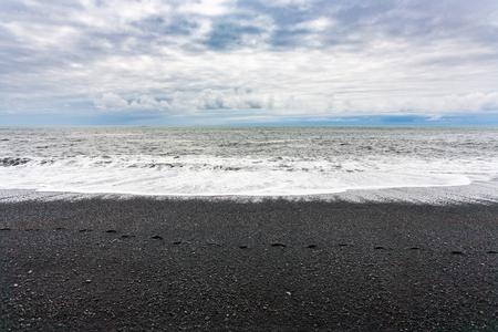 travel to Iceland - waves on Reynisfjara black Beach in Iceland, near Vik I Myrdal village on Atlantic South Coast in Katla Geopark in september Stok Fotoğraf - 90742287