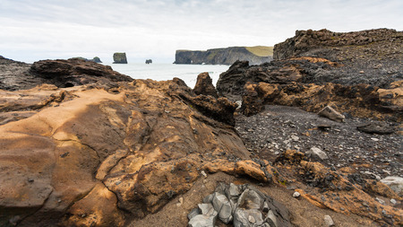 travel to Iceland - Atlantic ocean volcanic beach and view of Dyrholaey promontory near Vik I Myrdal village on Atlantic South Coast in Katla Geopark in september Stok Fotoğraf
