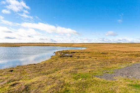 travel to Iceland - tundra landscape near Leirvogsvatn lake in Iceland in sunny september day