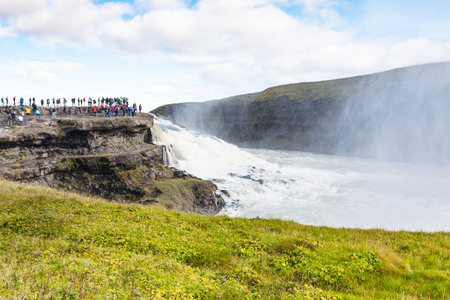 travel to Iceland - tourists on observation deck near Gullfoss waterfall in september Standard-Bild