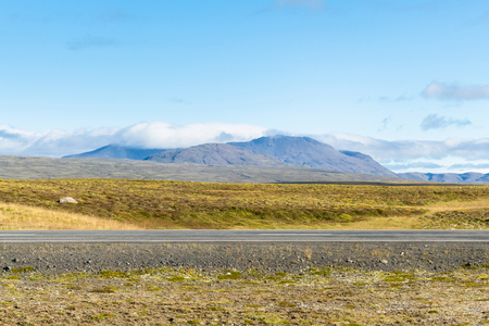 travel to Iceland - country road Thingvallavegur in Iceland in sunny september day Stock Photo