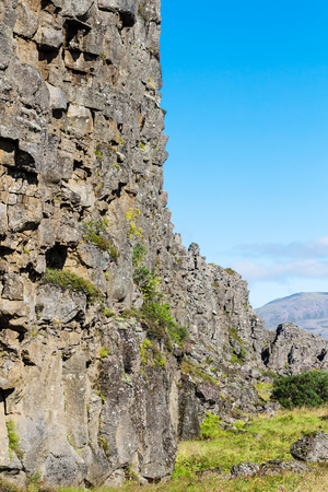 travel to Iceland - stone walls of Almannagja Fault in Thingvellir national park in autumn