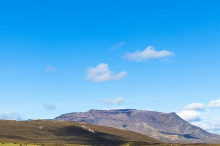 travel to Iceland - blue sky over mountain along Laugarvatnsvegur road near Efsti-Dalur village in Iceland in september