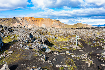 travel to Iceland - waymark at Laugahraun volcanic lava field in Landmannalaugar area of Fjallabak Nature Reserve in Highlands region of Iceland in september Stock Photo
