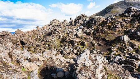 travel to Iceland - rocks on volcanic slope at Laugahraun lava field in Landmannalaugar area of Fjallabak Nature Reserve in Highlands region of Iceland in september