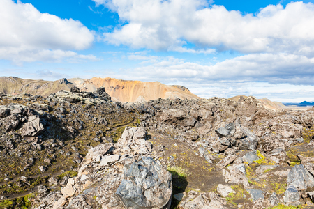 travel to Iceland - old stones at Laugahraun volcanic lava field in Landmannalaugar area of Fjallabak Nature Reserve in Highlands region of Iceland in september