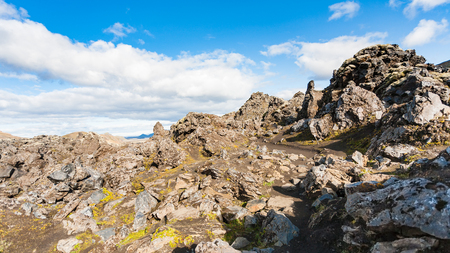 travel to Iceland - path between rocks on volcanic slope at Laugahraun lava field in Landmannalaugar area of Fjallabak Nature Reserve in Highlands region of Iceland in september