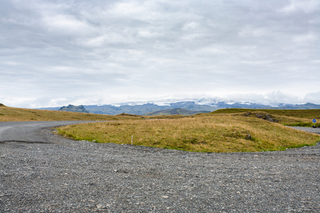 travel to Iceland - surface of dirty Dyrholavegur road on Dyrholaey peninsula, near Vik I Myrdal village on Atlantic South Coast in Katla Geopark in september Stok Fotoğraf - 90742927