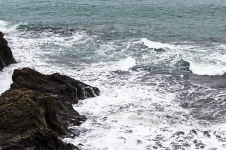 travel to Iceland - surf on rock coast of Atlantic ocean near Vik I Myrdal village on Atlantic South Coast in Katla Geopark in september
