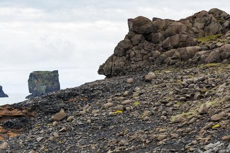 travel to Iceland - volcanic stones on Kirkjufjara beach near Vik I Myrdal village on Atlantic South Coast in Katla Geopark in september Stok Fotoğraf - 90742952