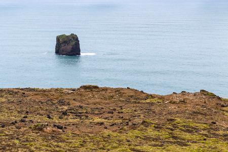 travel to Iceland - rock in Atlantic ocean near Dyrholaey promontory, near Vik I Myrdal village on Atlantic South Coast in Katla Geopark in september Stok Fotoğraf - 90742974