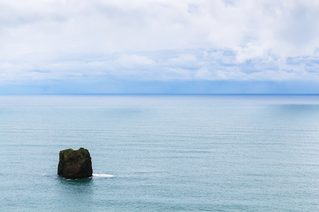 travel to Iceland - stack in Atlantic ocean near Dyrholaey promontory, near Vik I Myrdal village on Atlantic South Coast in Katla Geopark in september