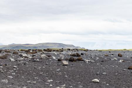 travel to Iceland - surface of Reynisfjara black sand lava beach in Iceland, near Vik I Myrdal village on Atlantic South Coast in Katla Geopark in september Stok Fotoğraf - 90743081