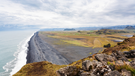 travel to Iceland - view of Solheimafjara beach from Dyrholaey promontory near Vik I Myrdal village on Atlantic South Coast in Katla Geopark in september