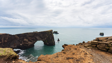 travel to Iceland - view of stone arch on Dyrholaey cliff near Vik I Myrdal village on Atlantic South Coast in Katla Geopark in september