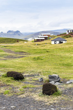 travel to Iceland - country houses in Vik I Myrdal village in Iceland on Atlantic South Coast in Katla Geopark in september